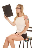 Woman tattoo tank book up read — Stock Photo