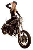 Woman cop motorcycle hand by hat stand — Stock Photo