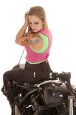 Woman tattoo motorcycle sit backwards look down — Stock Photo