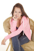 Teen girl in wicker jacket sitting in a wicker chair — Stock Photo