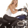 Woman white top black pants sit motorcycle looking — Stock Photo
