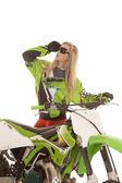 Woman glasses green dirt bike look up — Stock Photo
