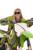 Woman behind green dirt bike glasses — Stock Photo