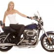 Woman sit on motorcycle black pants serious — Stock Photo