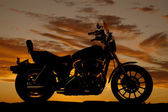 Silhouette motorcycle side sunset — Stock Photo