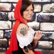 Woman red cape tattoo claw growl — Stock Photo