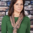 Womscarf green shirt brick wall serious — Stockfoto #32153217