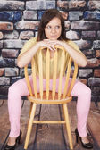 Woman pink pants rock wall sit look side — Stock Photo