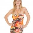 Woman in flower dress smile hands hips — Stock Photo #33455629