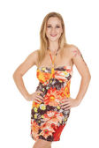 Woman in flower dress smile hands hips — Stock Photo