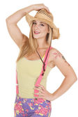 Woman pink suspenders hat hold — Stock Photo
