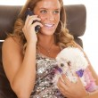 Puppy talking on phone — Stock Photo