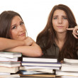 Two women books finger on cheek — Stock Photo