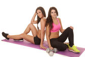 Two women fitness sit mat by weights — Stock Photo