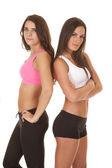 Två kvinnor fitness sport rygg mot rygg Bh — Stockfoto