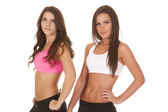 Two women fitness upper body sports bras — Stock Photo