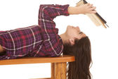 Woman close lay on back reading — Stock Photo