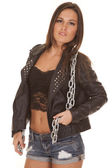 Woman black jacket over lace chain around neck — Стоковое фото