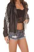 Woman black jacket over lace chain body — Стоковое фото