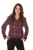 Woman plaid shirt hands hips smile — Stock Photo