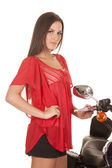 Woman red top motorcylce stand — Stockfoto