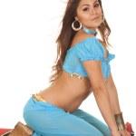 Woman on carpet hair blow on knees looking — Foto Stock