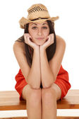 Woman red dress hat facing — Foto Stock