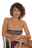 Hispanic woman close sitting in a dress serious — Foto de Stock
