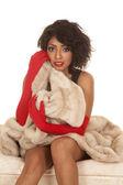Hispanic woman red gloves fur coat sit — Foto de Stock