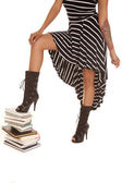 Woman body step on books — Stockfoto