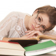 Woman lay on books glasses look over — Stock Photo