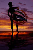 Silhouette of woman with big beach ball — Stock Photo