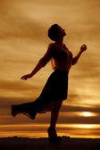 Silhouette woman sheer skirt leg up back — Stock Photo
