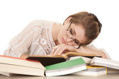 Woman lay on books sleeping — Stockfoto