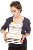 Woman stack of books holding look at — Photo