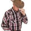 Cowboy hat over eyes hand in belt — Stock Photo
