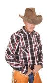 Cowboy hat over eyes hands in belt — Stock Photo