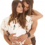 Couple long hair man behind Native american woman eyes closed — Stock Photo