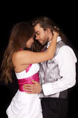 Couple in formals hug look at each other — Stock Photo
