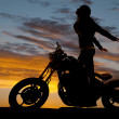 Постер, плакат: Silhouette woman motorcycle stand hands back