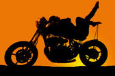 Silhouette woman on motorcycle lay back toes up — Photo