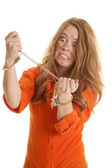 Woman inmate cuffs crazy — Stock Photo