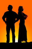 Silhouette couple mad arms folded — Stock Photo
