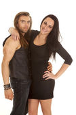 Couple in black both looking — Stockfoto