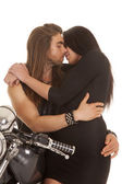Couple motorcycle wear black almost to kiss — Stock Photo
