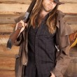 Cowboy duster long hair rifle on shoulder look — Stock Photo