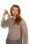 Man chain mail sword behind back — Stock Photo