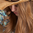 Stock Photo: Womcowboy hat plaid close face partly hidden