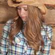 Woman cowboy hat plaid look down — Stock Photo