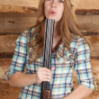 Foto de Stock  : Cowgirl shotgun blow barrel